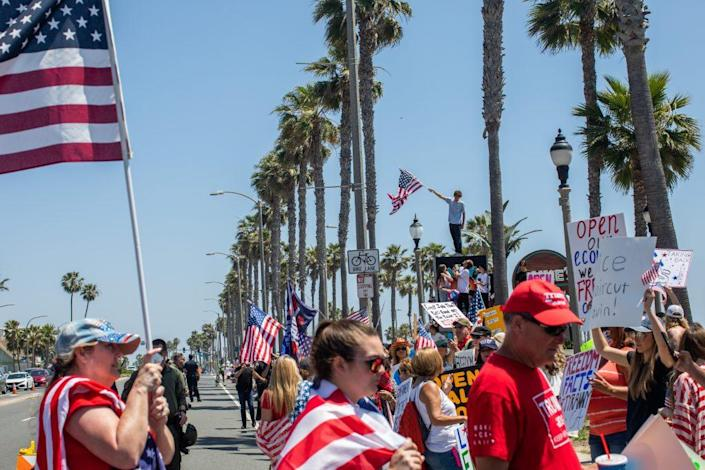 Protesters gather in a demonstration against Gov. Gavin Newsom on May 01, 2020 in Huntington Beach, California. (Photo by Apu Gomes/Getty Images)