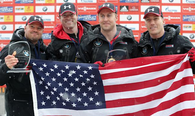 Steven Holcomb of the United States, from left, poses with his team Curtis Tomasevicz, Steven Langton and Christopher Fogt after winning their four-man Bobsled World Cup race in Koenigssee, southern Germany, on Sunday, Jan. 26, 2014. (AP Photo/Matthias Schrader)