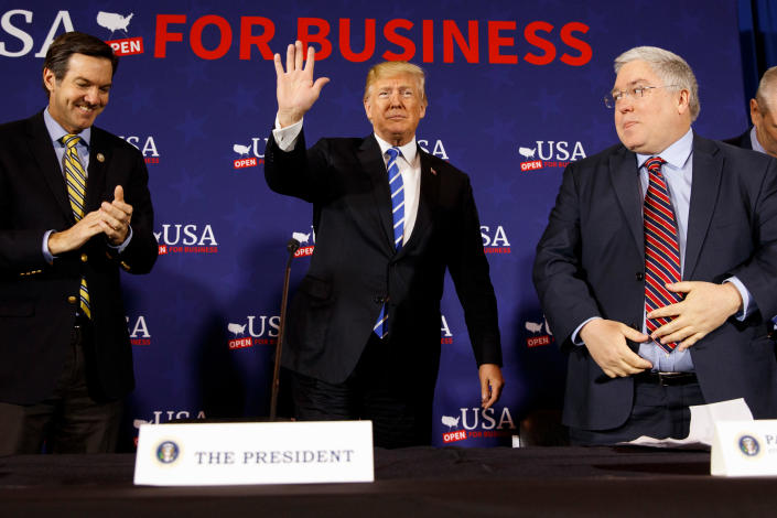 Rep. Evan Jenkins, left, and West Virginia Attorney General Patrick Morrisey greet President Trump at a roundtable discussion in White Sulphur Springs, W.Va., on April 5. (AP Photo/Evan Vucci)