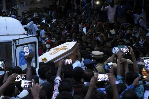 The coffins of J. Jayaraj and Bennicks Immanuel were carried through the crowd in the southern Indian state of Tamil Nadu