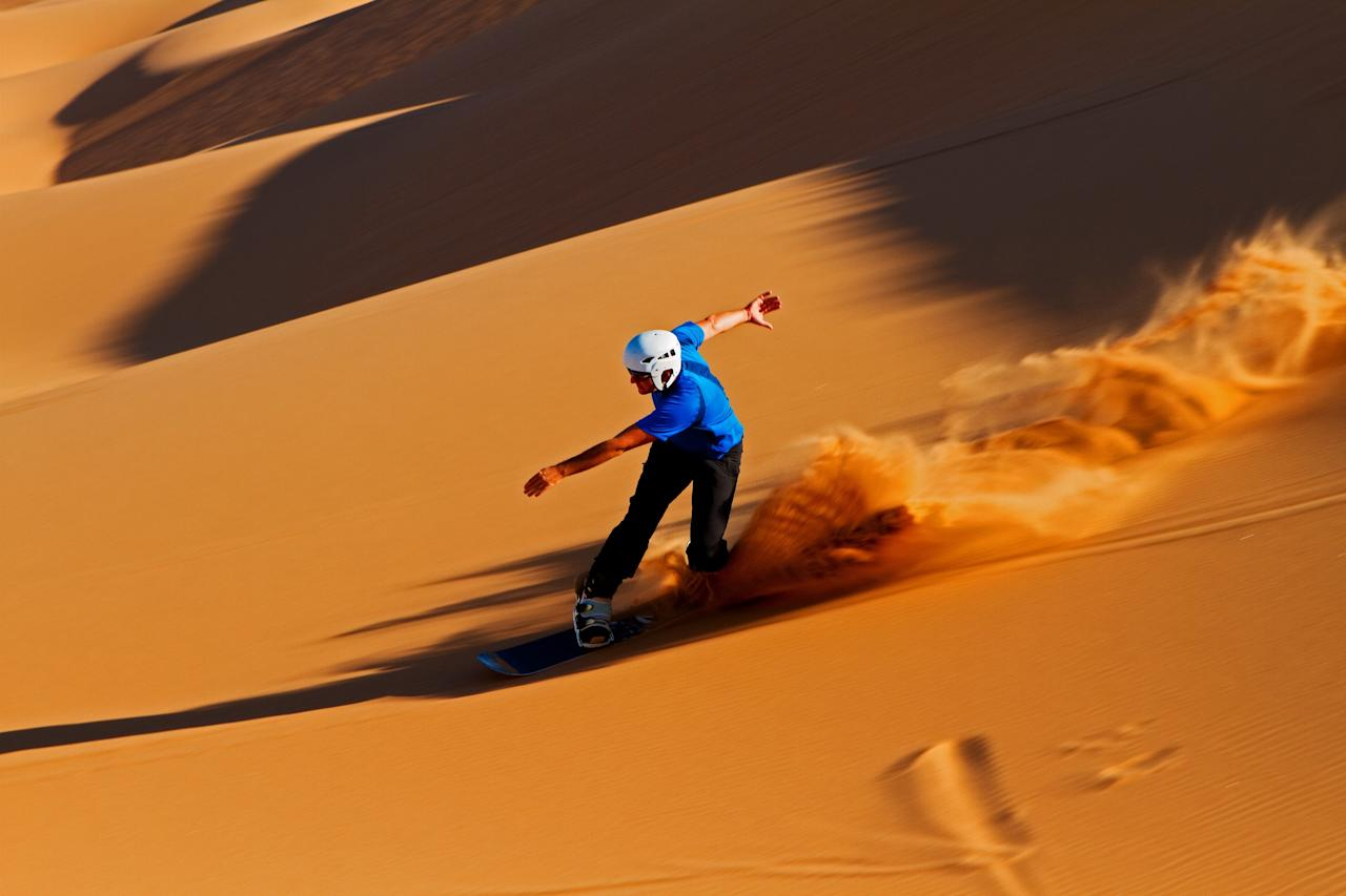 "Snow is scarce in Namibia. And while traditional skiing isn't an option, the locals have gotten creative by making the most out of the desert terrain. A popular slope-inspired pastime is now <a href=""https://www.theoutbound.com/namibia/chillin/sandboard-the-namib-desert"">sandboarding the world's oldest desert</a> (aka the Namib Desert). The best part is, it's available year-round."