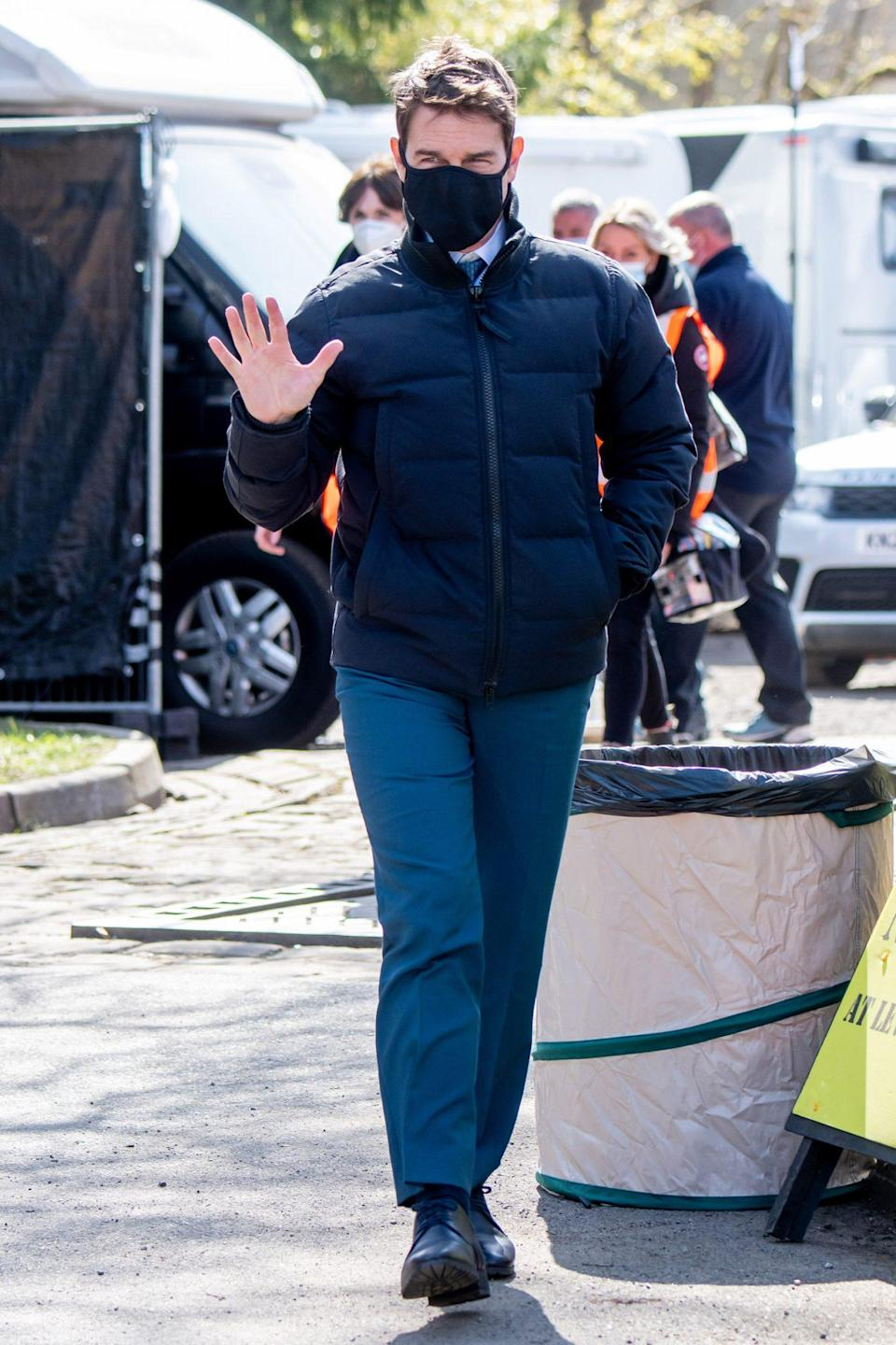 <p>Tom Cruise waves as he heads to the set of <em>Mission: Impossible 7</em> in Pickering, England, on Wednesday.</p>