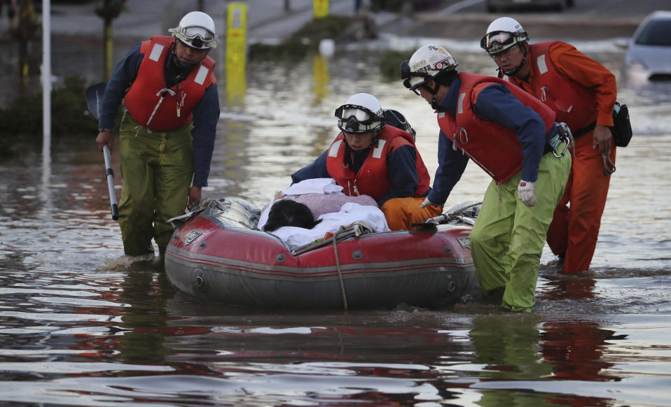 Firefighters conduct rescue operation in Motomiya City, one day after Typhoon Hagibis, a powerful super typhoon. Source: The Yomiuri Shimbun via AP Images.