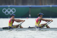 Ancuta Bodnar and Simona Radis of Romania compete in the women's rowing double sculls final at the 2020 Summer Olympics, Wednesday, July 28, 2021, in Tokyo, Japan. (AP Photo/Lee Jin-man)