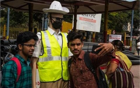 Dressed in police caps, white shirts and brown trousers, and wearing sunglasses, the mannequins are now on duty at congested junctions - Credit: Asif Saud/BBC