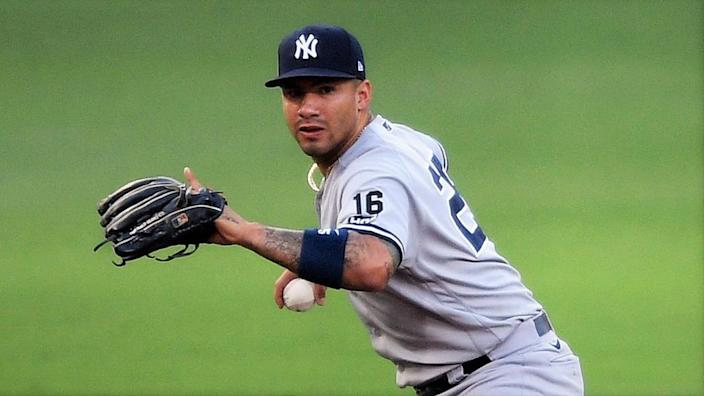 Oct 9, 2020; San Diego, California, USA; New York Yankees shortstop Gleyber Torres (25) holds the ball after being unable to handle a ball hit by Tampa Bay Rays designated hitter Yandy Diaz (not pictured) during the fourth inning of game five of the 2020 ALDS at Petco Park. Torres was charged with an error on the play.