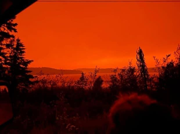 Amanda Sainnawap's photo shows the haze and glow from nearby forest fires as she left Pikangikum in northwestern Ontario on Monday afternoon. (Submitted by Amanda Sainnawap - image credit)
