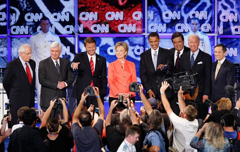 Democratic presidential hopefuls, from left: former Senator Mike Gravel, Senator Christopher Dodd, former Senator John Edwards, Senator Hillary Rodham Clinton, Senator Barack Obama, New Mexico Governor Bill Richardson, Senator Joe Biden, and Representative Dennis Kucinich stand together before the start of the debate sponsored by CNN, YouTube and Google at The Citadel military college in Charleston, S.C., on July 23, 2007. | Charles Dharapak—AP