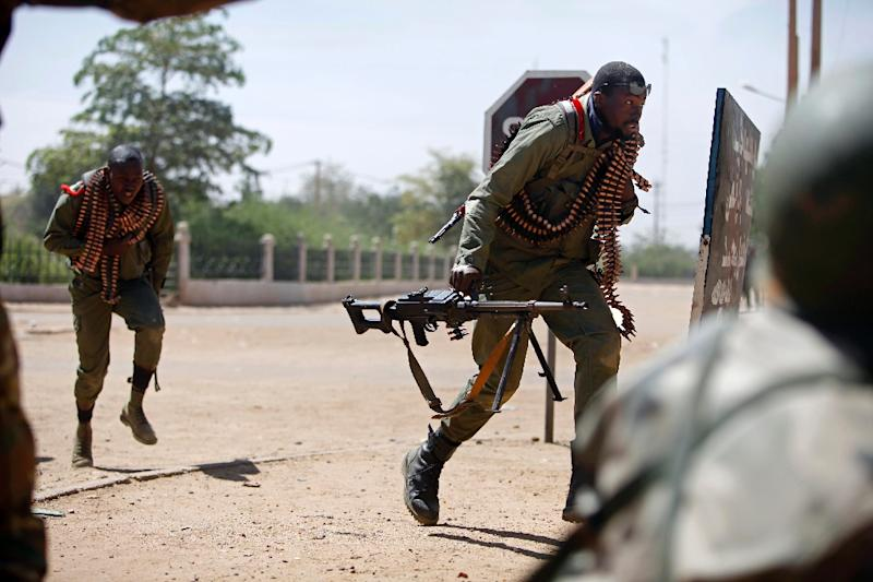 Malian troops, pictured in a file photo, killed several jihadists near the country's southern border with Ivory Coast and destroyed the insurgents' camp in a forest straddling the frontier, several Malian military officials said (AFP Photo/Frederic Lafargue)