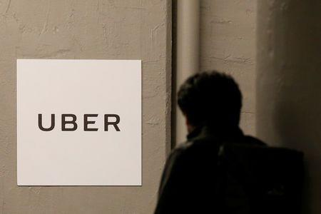 A man arrives at the Uber offices in Queens, New York