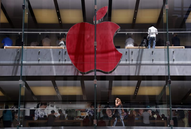Apple logo on display at the Sydney Apple Store is illuminated in red to mark World AIDS Day, in Sydney