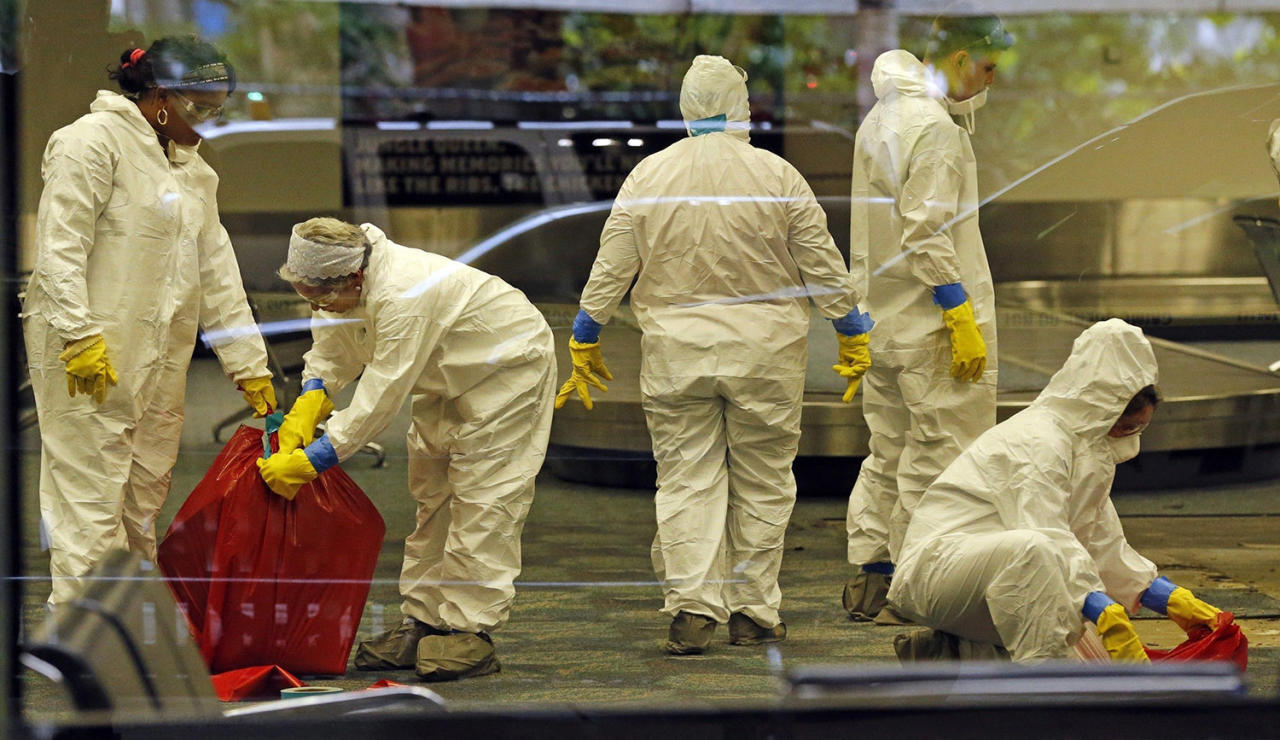 <p>A hazmat crew cleans up baggage claim Terminal Two on Saturday, Jan. 7, 2017 at Fort Lauderdale-Hollywood International Airport Terminal the day after multiple people were shot on Friday. (Al Diaz/Miami Herald via AP) </p>