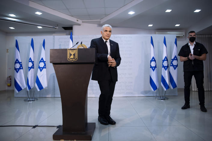 """REPLACES COMMON GOOD INSTEAD OF COMMON GROUND - Israeli opposition leader Yair Lapid, poses for a photo during a news conference in Tel Aviv, Thursday, May. 6, 2021. Lapid called on his potential partners to find """"common good"""" and expressed optimism that a new coalition government would be formed. (AP Photo/Oded Balilty)"""