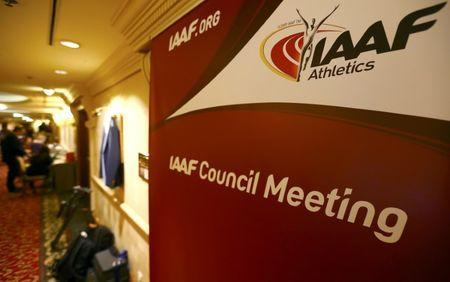 Journalists are seen near a logo of the International Association of Athletics Federations (IAAF) at a hotel where the IAAF council holds a meeting in Vienna, Austria, June 17, 2016. REUTERS/Leonhard Foeger Picture Supplied by Action Images
