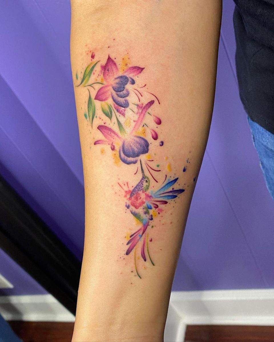 Tattoo designs don't get more colorful—or eye-catching—than this.