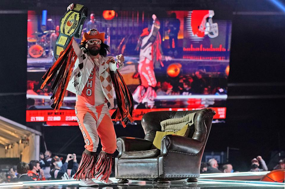 "Cleveland Browns fan ""Macho Man"" dances on stage as the Browns are on the clock in the second round of the NFL football draft, Friday, April 30, 2021, in Cleveland."