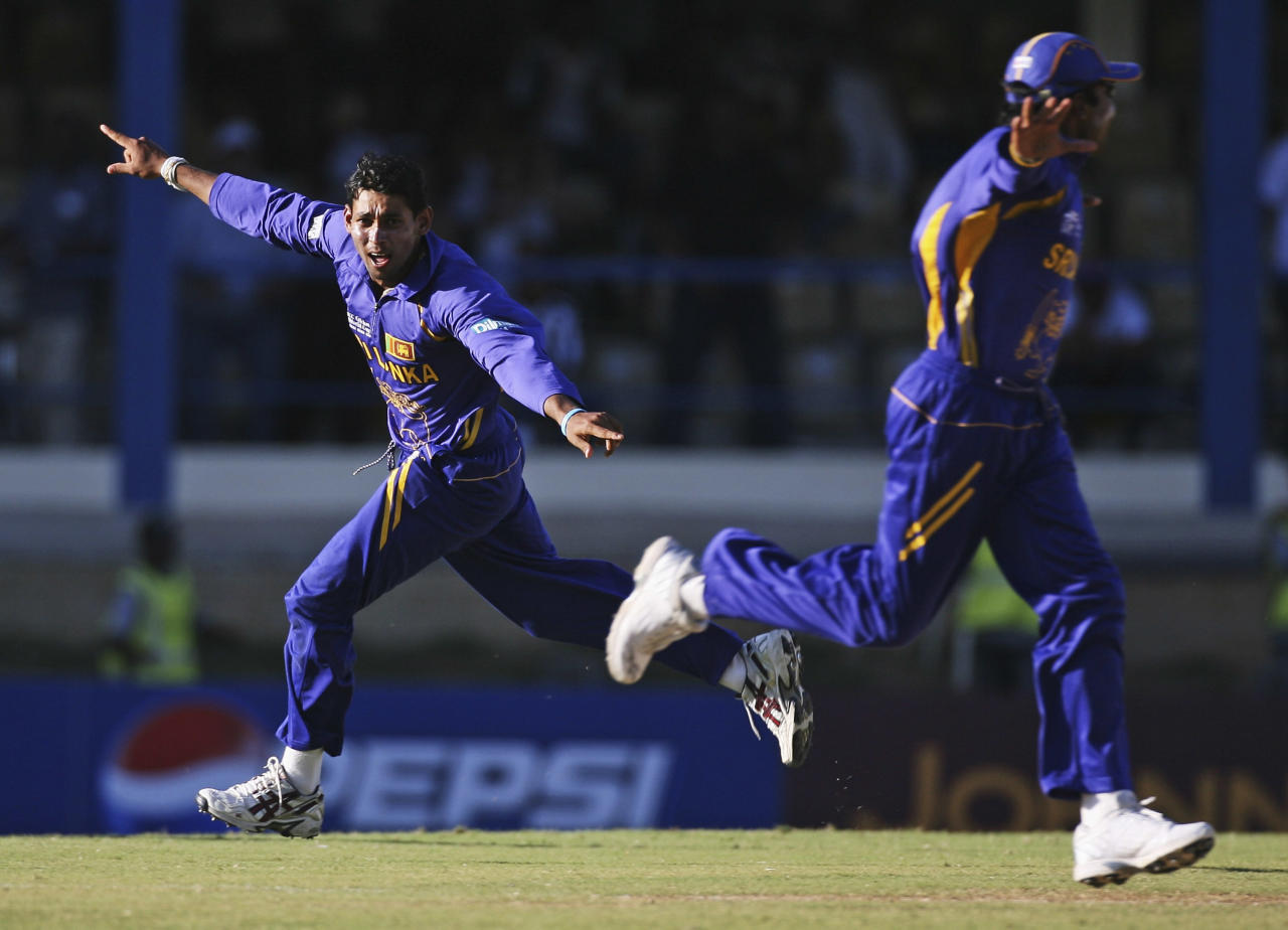 PORT OF SPAIN, TRINIDAD AND TOBAGO - MARCH 23:  Tillakaratne Dilshan of Sri Lanka celebrates the final wicket of Munaf Patel of India during the ICC Cricket World Cup 2007 Group B match between India and Sri lanka at the Queens Park Oval Cricket Ground on March 23, 2007 in Port of Spain, Trinidad.  (Photo by Clive Rose/Getty Images)