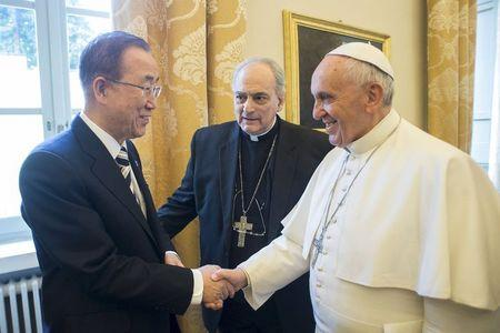 Pope Francis shakes hands with United Nations Secretary-General Ban Ki-moon during a meeting at the Vatican