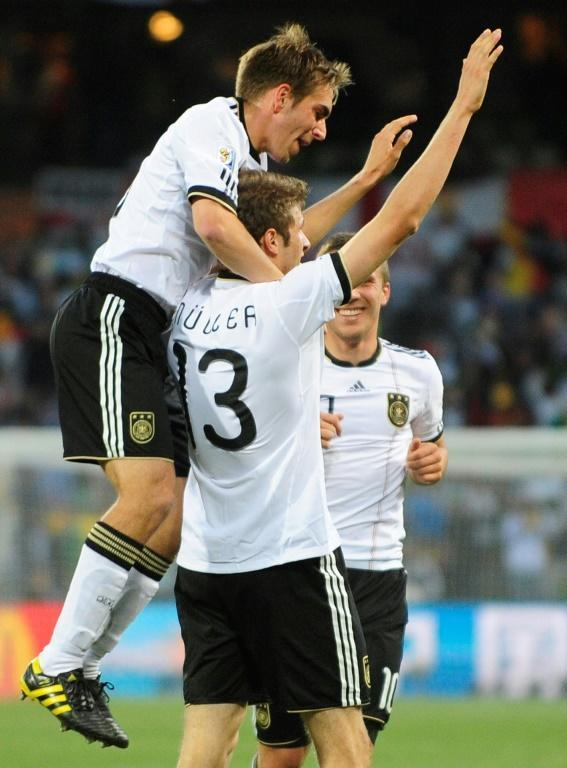 Mueller time: Thomas Mueller (centre) scored twice as Germany thumped England 4-1 at the 2010 World Cup