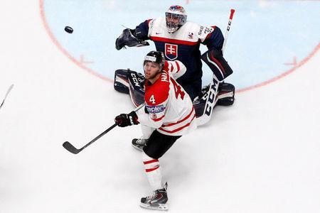 2016 IIHF World Championship - Group B - Canada v Slovakia - St. Petersburg, Russia - 14/5/16 - Taylor Hall of Canada in action with Julius Hudacek of Slovakia. REUTERS/Maxim Zmeyev
