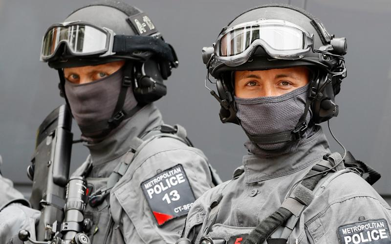 Police counter terrorism officers pose during a media opportunity in London in August last year - Copyright 2016 The Associated Press. All rights reserved. This material may not be published, broadcast, rewritten or redistribu