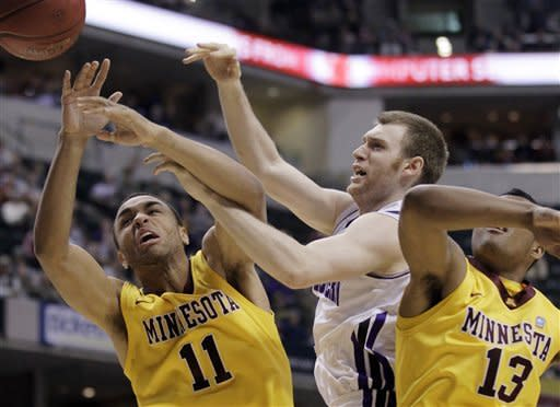 Minnesota guards Joe Coleman (11) and Maverick Ahanmisi (13) battle for a loose ball against Northwestern guard Alex Marcotullio in the first half of an NCAA college basketball game at the first round of the Big Ten Conference tournament in Indianapolis, Thursday, March 8, 2012. (AP Photo/Michael Conroy)