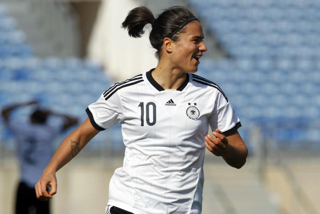 Germany's Dzsenifer Marozsan celebrates after scoring her side's third goal during the women's soccer Algarve Cup final match between Germany and Japan at the Algarve stadium, outside Faro, southern Portugal, Wednesday, March 12, 2014. (AP Photo/Francisco Seco)