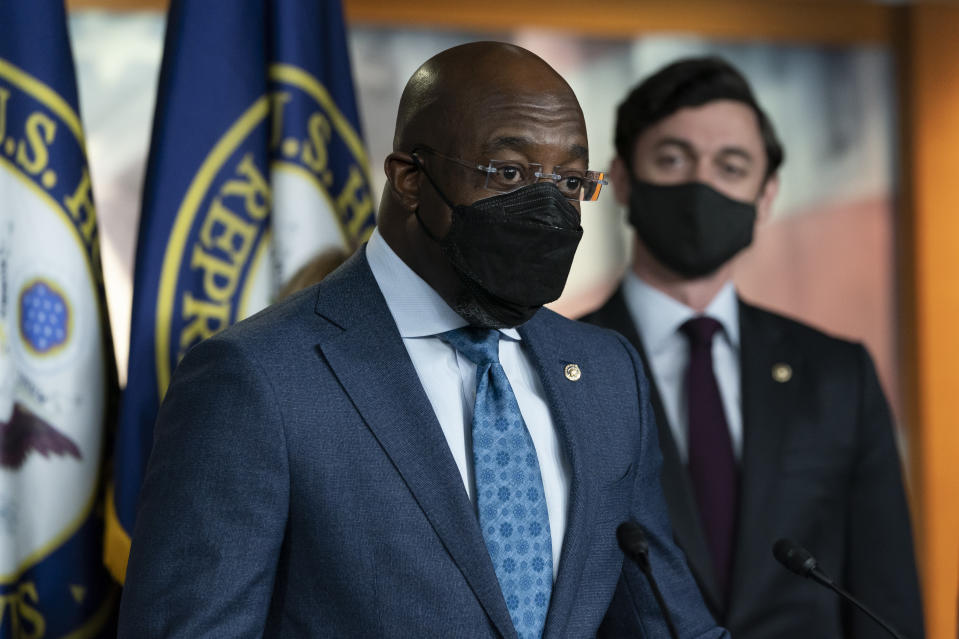 Sen. Raphael Warnock, D-Ga., left, accompanied by Sen. Jon Ossoff, D-Ga., speaks during a news conference, before the vote on the Democrat's $1.9 trillion COVID-19 relief bill, on Capitol Hill, Wednesday, March 10, 2021, in Washington. (AP Photo/Alex Brandon)