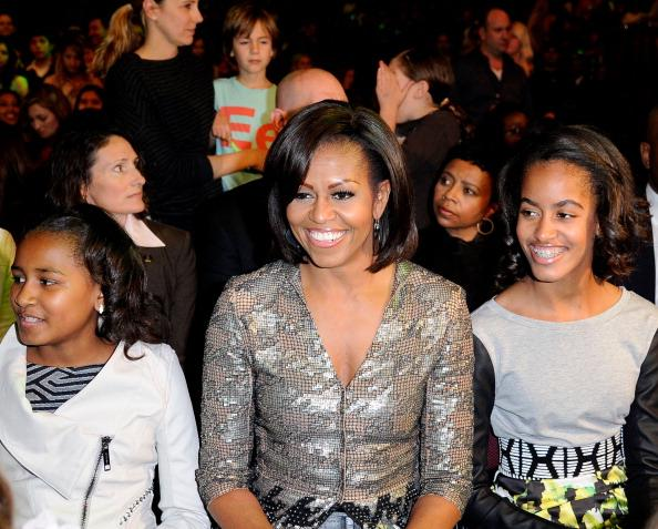 Sasha Obama, First Lady Michelle Obama and Malia Obama at Nickelodeon's 25th Annual Kids' Choice Awards held at Galen Center on March 31, 2012 in Los Angeles, California. (Photo by Kevork Djansezian/Getty Images)