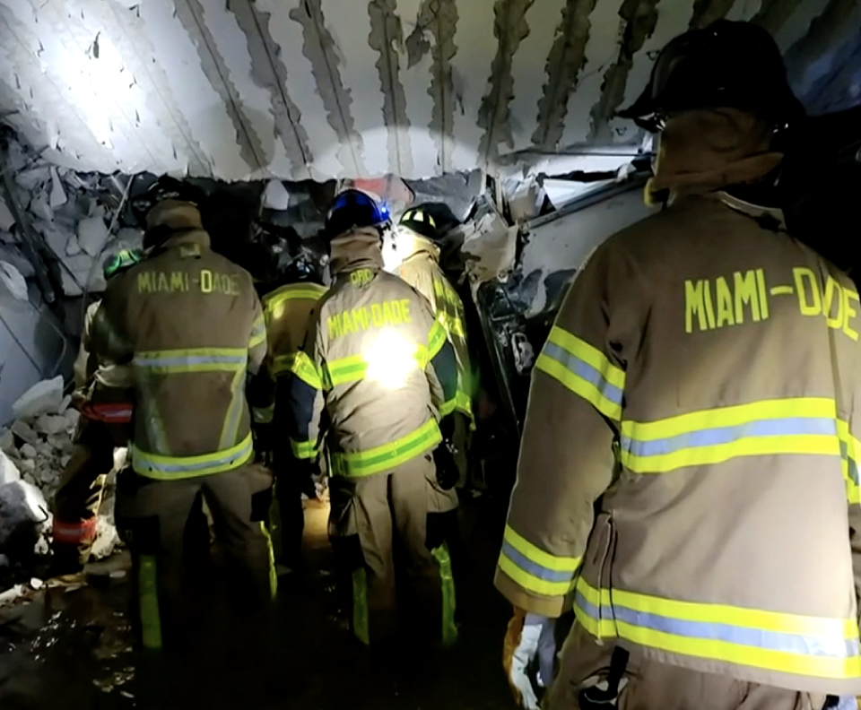 Crews in the collapsed Champlain Towers building in Florida.