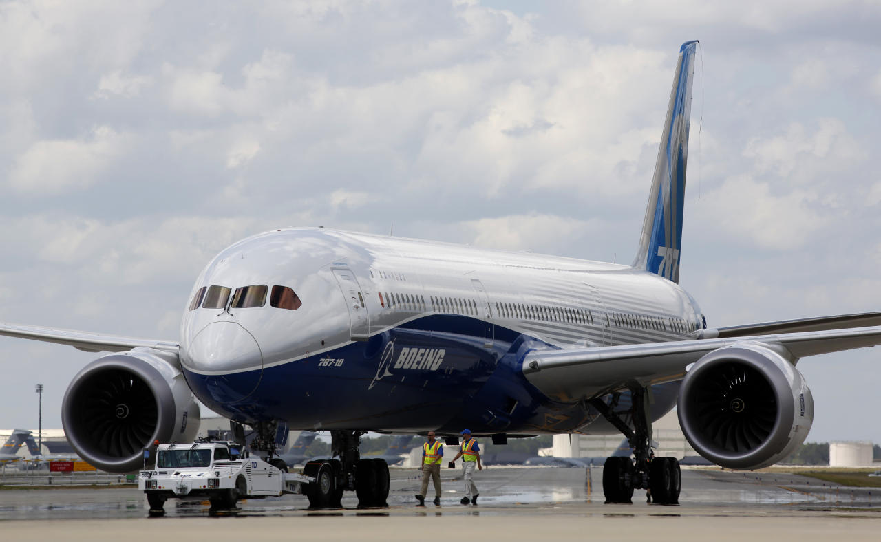 <p> FILE - In this Friday, March 31, 2017, file photo, Boeing employees walk the new Boeing 787-10 Dreamliner down towards the delivery ramp area at the company's facility in South Carolina after conducting its first test flight at Charleston International Airport in North Charleston, S.C. The Boeing Co. reports earnings, Wednesday, April 26, 2017. (AP Photo/Mic Smith) </p>