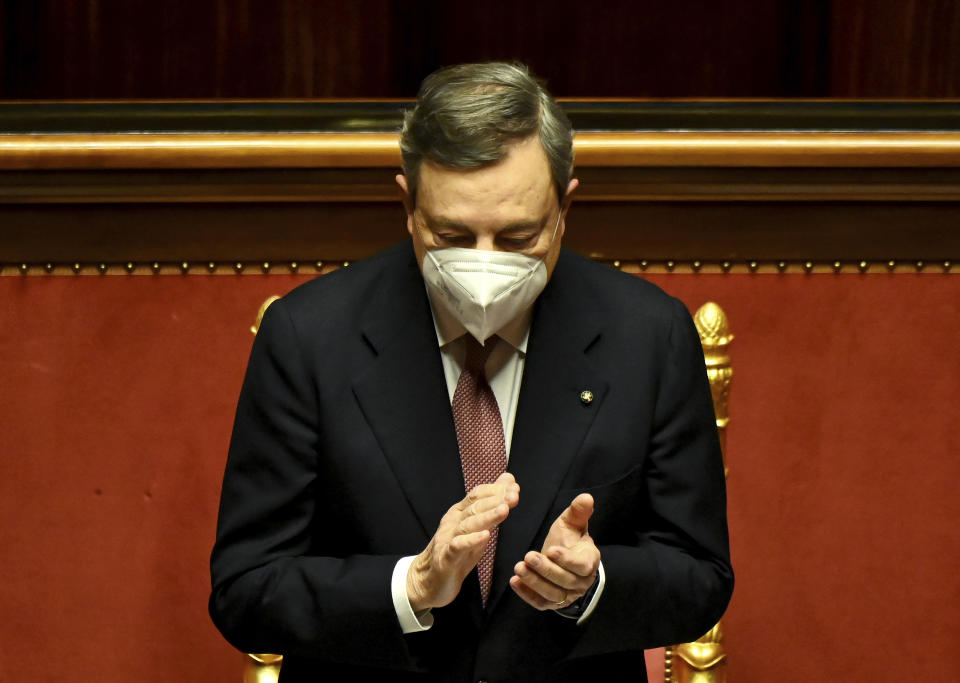 <p>Italy's Prime Minister Mario Draghi applauds following the speech of the Senate speaker, prior to himself addressing the Senate the Senate in Rome Wednesday, Feb. 17, 2021, before submitting his government to a vote of confidence. (Alberto Pizzoli/POOL photo via AP)</p>