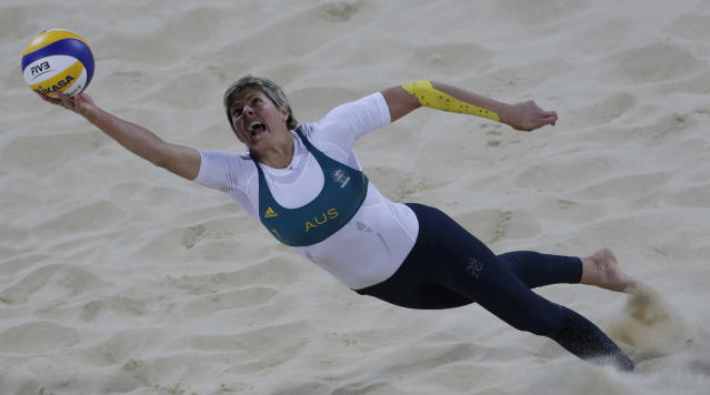 Australia's Natalie Cook dives for the ball during a beach volleyball match against the United States at the 2012 Summer Olympics, Saturday, July 28, 2012, in London. (AP Photo/Dave Martin)