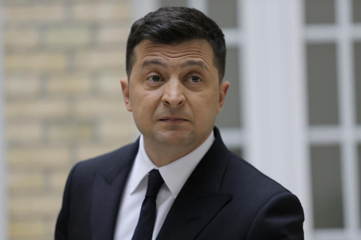 Ukrainian President Volodymyr Zelenskyy reacts during a press conference at the Ukrainian Embassy to France, Friday, April 16, 2021, in Paris. Ukrainian President Volodymyr Zelenskyy held talks with French President Emmanuel Macron and German Chancellor Angela Merkel amid his country's growing tensions with neighboring Russia, which has deployed troops near its border with Ukraine. (AP Photo/Lewis Joly)