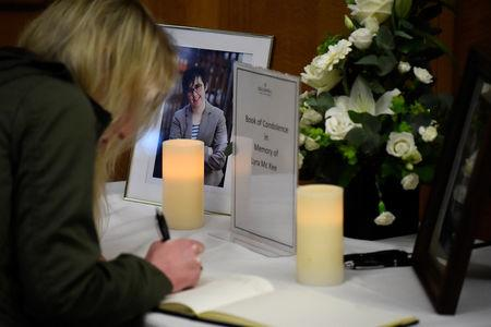 FILE PHOTO: A woman signs a book of condolences in the Guildhall for the 29-year-old journalist Lyra McKee who was shot dead in Londonderry, Northern Ireland April 20, 2019. REUTERS/Clodagh Kilcoyne/File Photo