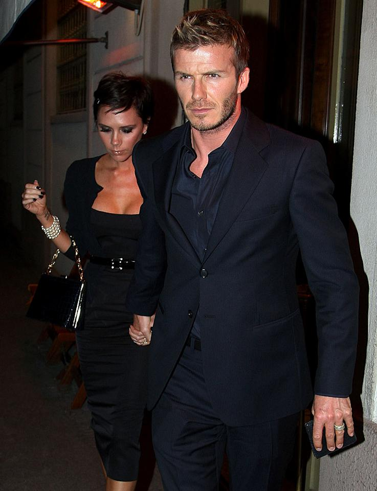 "David and Victoria Beckham enjoyed dinner at ""Da Giacomo"" restaurant in Italy, where he's on loan to AC Milan. Although the soccer star plans to return to the LA Galaxy mid-season, he doesn't expect a reception from some fans. <a href=""http://www.gettyimages.com/"" target=""new"">GettyImages.com</a> - March 8, 2009"