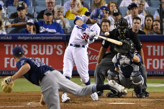 Los Angeles Dodgers' Cody Bellinger hits a solo home run off Tampa Bay Rays relief pitcher Emilio Pagan, foreground, during the eighth inning of a baseball game Wednesday, Sept. 18, 2019, in Los Angeles. (AP Photo/Mark J. Terrill)