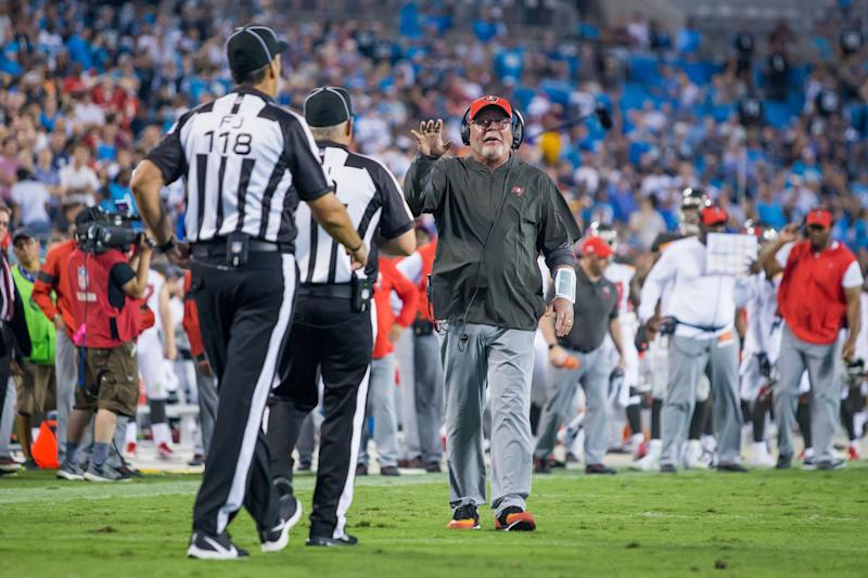 Tampa Bay Buccaneers coach Bruce Arians talks with officials during Thursday night's game. (Getty Images)