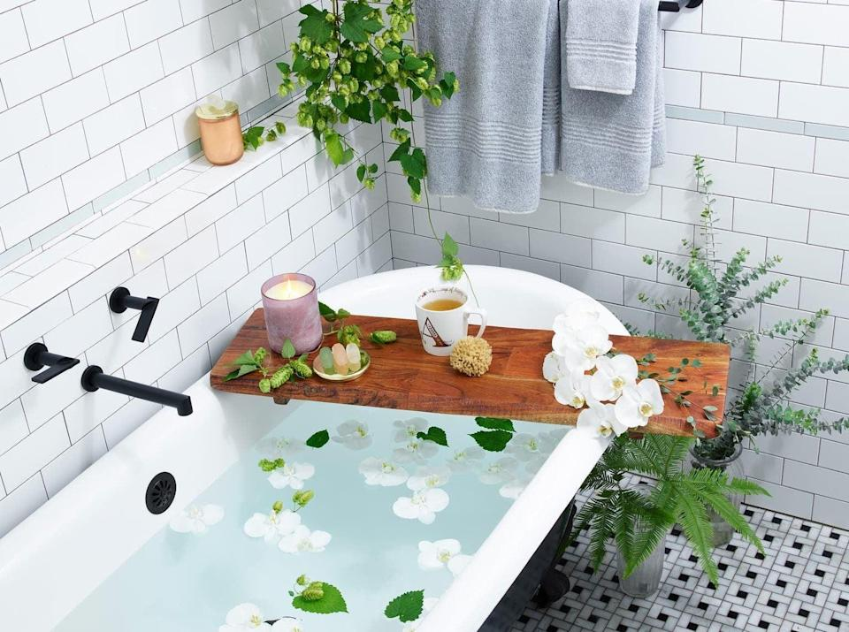 <p>Take a relaxing bath with the help of the <span>Treasure &amp; Bond Large Acacia Wood Tray</span> ($69). You'll love it so much, you'll want to get it one for everyone in your life too.</p>