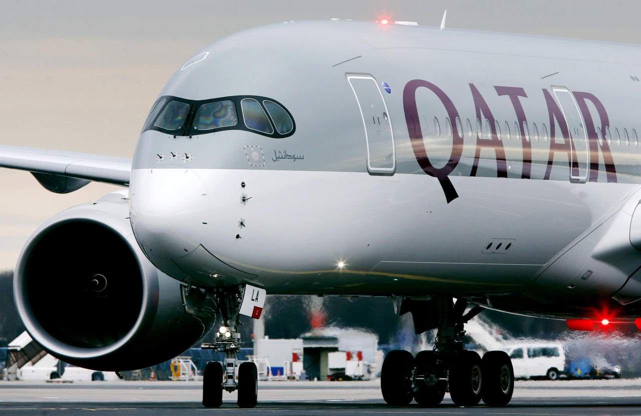 FILE - In this Jan. 15, 2015, file photo, a Qatar Airways jet arriving from Doha, Qatar, approaches the gate at the airport in Frankfurt, Germany. Qatar Airways said Tuesday, Sept. 18, 2018 that it suffered a loss of $69 million this year off revenue of $11.5 billion amid a boycott of Doha by four Arab nations. (AP Photo/Michael Probst, File)