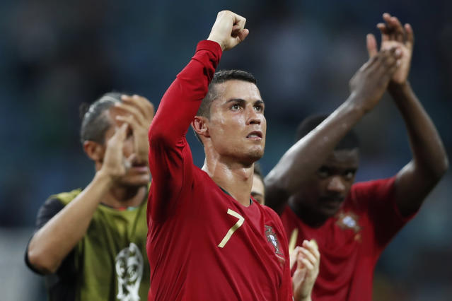 Portugal's Cristiano Ronaldo gestures to the fans at the end of the group B match between Portugal and Spain at the 2018 soccer World Cup in the Fisht Stadium in Sochi, Russia, Friday, June 15, 2018. (AP Photo/Francisco Seco)