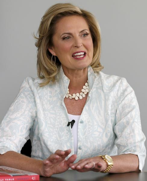 """In this Monday, Oct. 7, 2013 photo, Ann Romney, talks about her bestselling cookbook, """"The Romney Family Table: Sharing Home-Cooked Recipes & Favorite Traditions"""" during an interview with the Associated Press in Phoenix. (AP Photo/Ross D. Franklin)"""