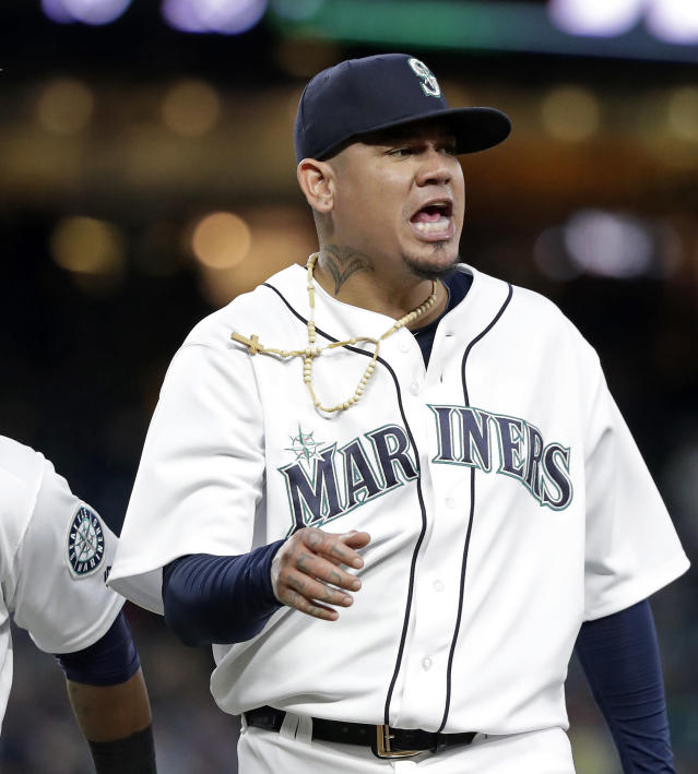 Seattle Mariners starting pitcher Felix Hernandez reacts to a double play against the Boston Red Sox that ended the top of the seventh inning of a baseball game Thursday, June 14, 2018, in Seattle. (AP Photo/Elaine Thompson)
