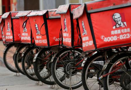 FILE PHOTO: Logos of KFC, owned by Yum Brands Inc, are seen on its delivery bicycles in front of its restaurant in Beijing