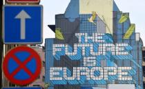 FILE PHOTO: A wall mural is seen near the EU Commission and Council buildings in Brussels, Belgium