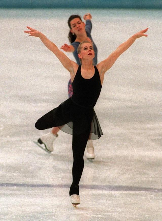 Tonya Harding (front) of the United States and compatriot Nancy Kerrigan skate during a practice session on February 22, 1994 in Hamar, near Lillehammer, at the Winter Olympic Games (AFP Photo/Eric Feferberg)