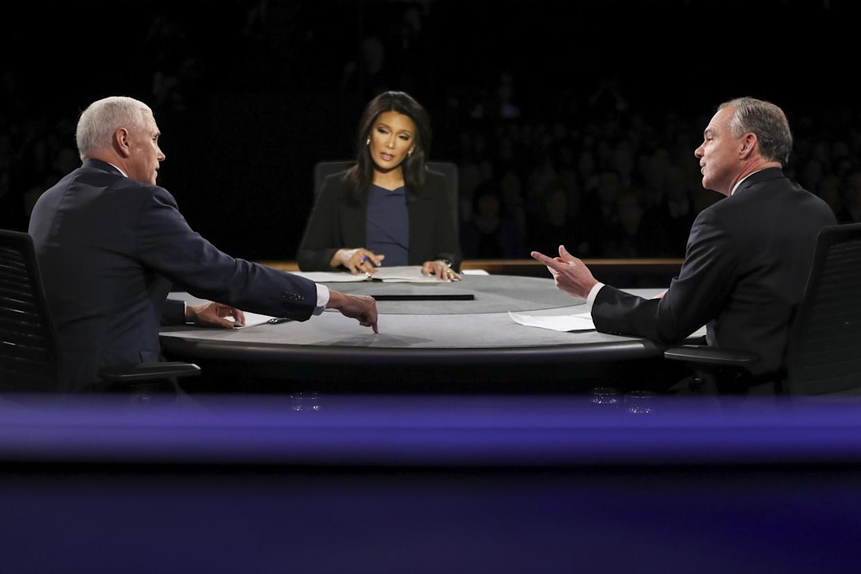 Republican vice presidential nominee Gov. Mike Pence, left, and Democratic vice presidential nominee Sen. Tim Kaine exchange opinions as moderator Elaine Quijano of CBS News listens during the debate at Longwood University in Farmville, Va., on Tuesday. (Photo: Joe Raedle/Pool via AP)