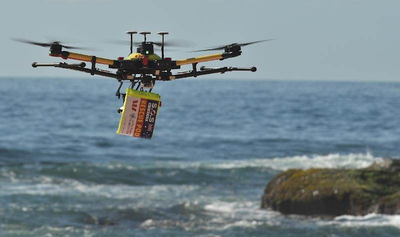 Along with spotting swimmers in trouble and dropping lifesaving devices to them, the drones are being used to spot predators such as sharks (AFP Photo/PETER PARKS)