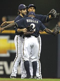 Ryan Braun (left), Nyjer Morgan and Carlos Gomez embrace after Milwaukee's 9-4 win over Arizona in Game 2 of the ALDS