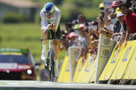 Switzerland's Stefan Kung crosses the finish line of the twentieth stage of the Tour de France cycling race, an individual time-trial over 30.8 kilometers (19.1 miles) with start in Libourne and finish in Saint-Emilion, France, Saturday, July 17, 2021. (AP Photo/Daniel Cole)